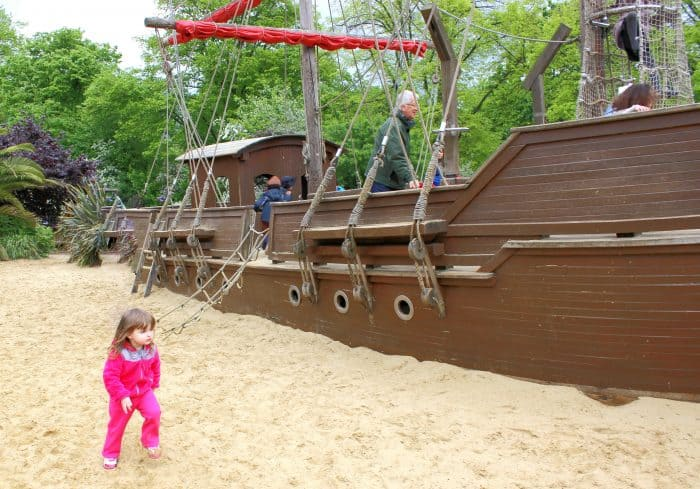 Kids having fun in London - playing on the pirate ship in Princess Diana's Memorial Gardens