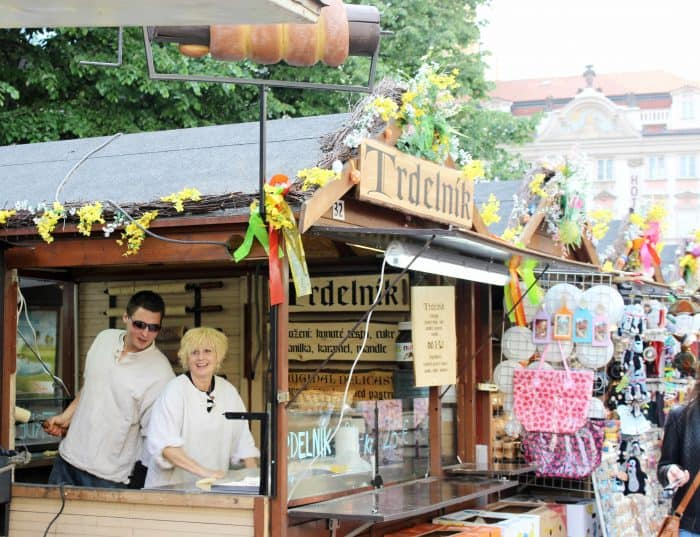 Easter market booth selling Trdelnik on our family trip to Prague