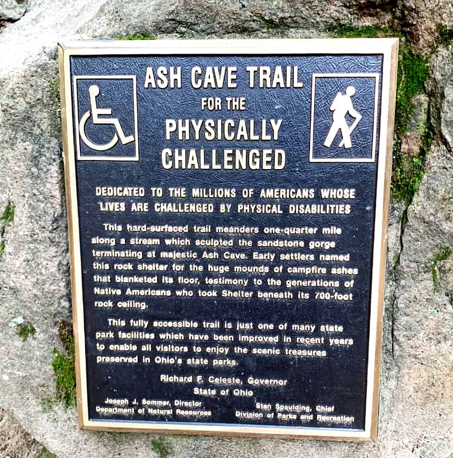 Plaque attached to a rock that describes how the Ash Cave Trail is accessible to the physically challenged