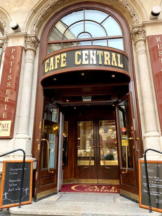 Entrance to Cafe Central in Vienna. Tall doors with Cafe Central sign on top and in doormat.