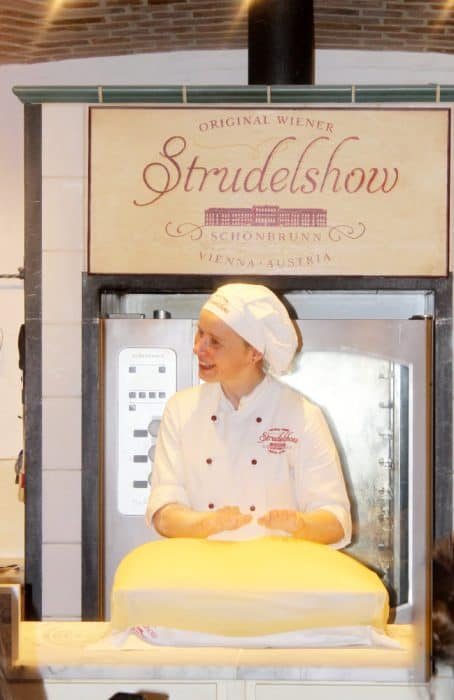 Baker in white hat and coat at the strudel show in Vienna