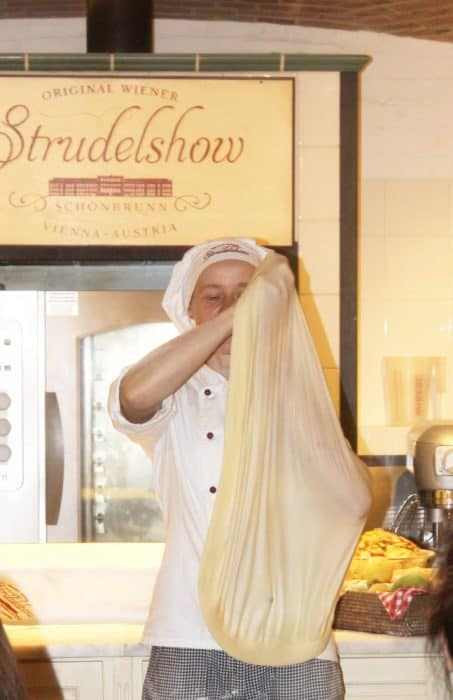 Strudel show baker stretching out the dough so that it was transparent