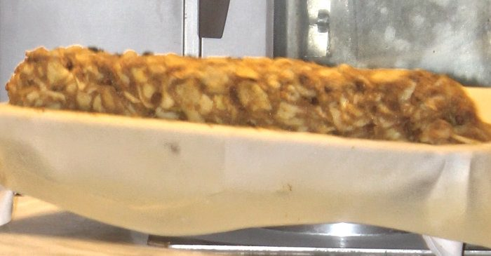 Mounds of apple strudel filling sitting on top of the dough at the Viennese strudel show