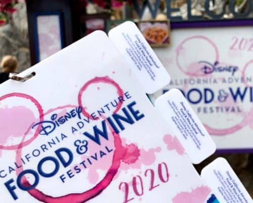 Foreground with California Adventure Food & Wine festival pass with white coupon tabs against a background of pictures of a welcome sign and dark pink flowers