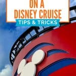 White Mickey head against a red background with blue waves with blue sky and white clouds in background with text reading Connect at Sea on a Disney Cruise Tips and Tricks