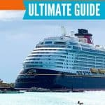 Large Disney cruise ship docked in a port with the text Disney Cruise Connect at Sea Ultimate Guide
