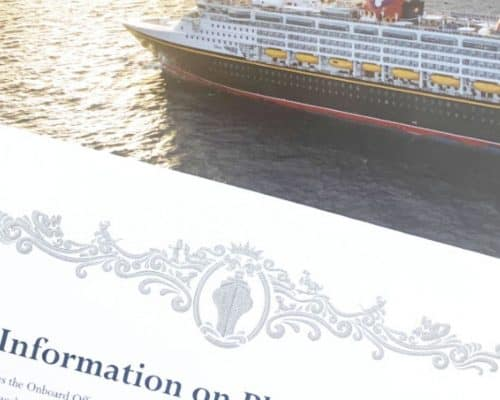 Disney cruise ship on the water with a white card in the lower left corner that says 'Information on placeholder'