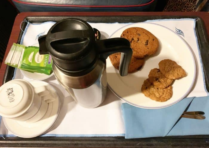 Serving tray with 2 white mugs, a stainless steel carafe and a plate of cookies from Disney Cruise room service menu