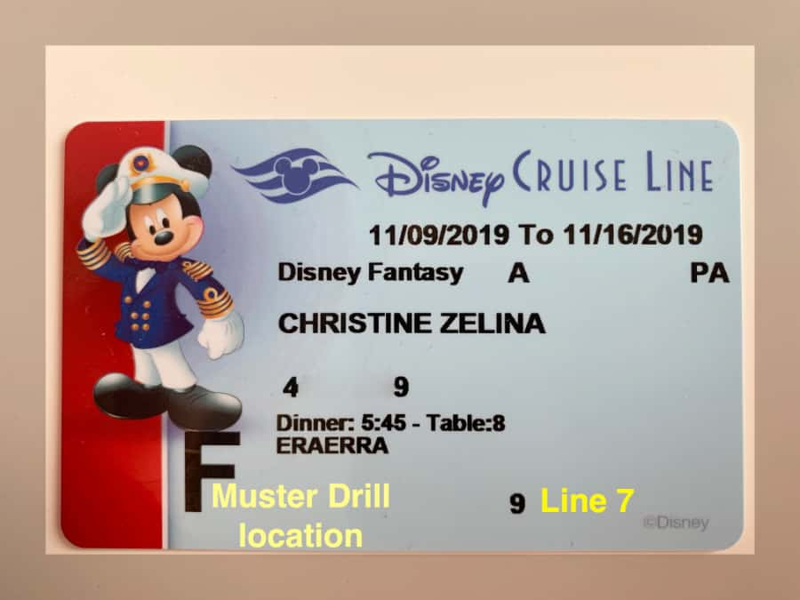 Blue credit card for Disney Cruise Line with Mickey and red stripe on left highlighting the muster drill location