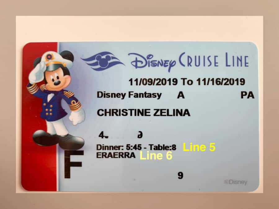 Blue Disney Cruise Line Key to the World card highlighting dining room seating