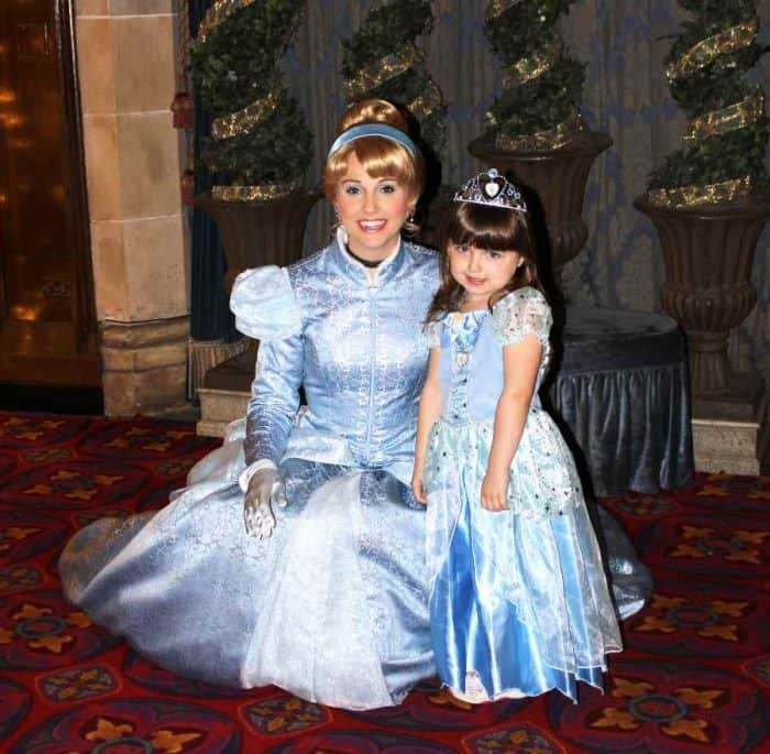 Woman and young girl dressed in light blue princess costumes
