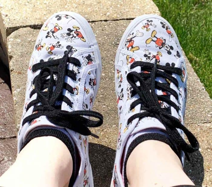 Pair of tennis shoes - white with red, yellow and black Mickey Mouse designs and black shoelaces