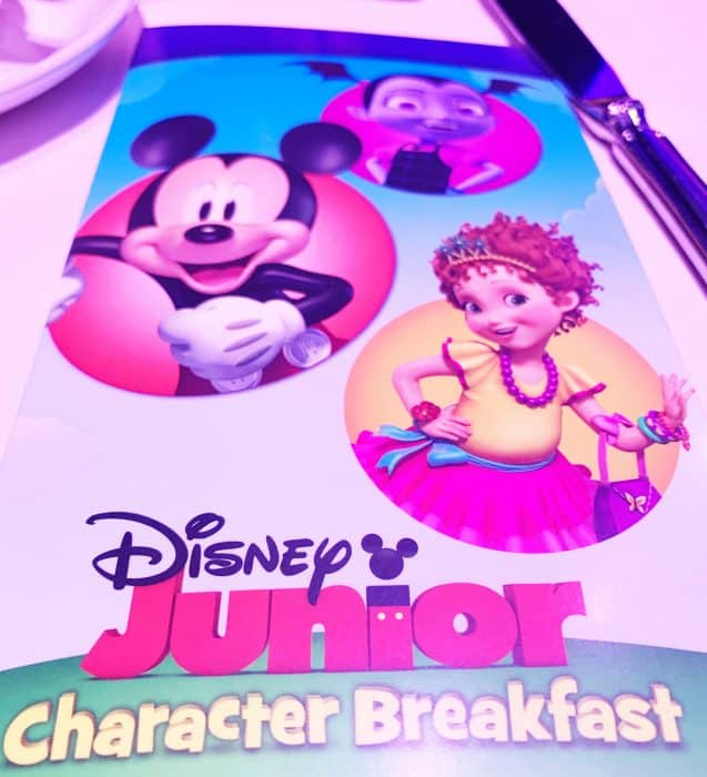 Colorful picture of Disney Jr friends at the character breakfast on a Disney cruise ship