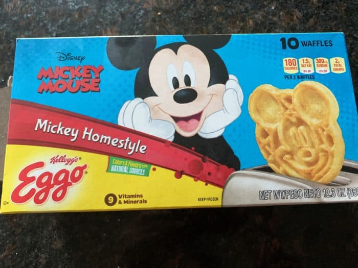 Box with a large Mickey Mouse in the center and a Mickey waffle popping out of a toaster on the right