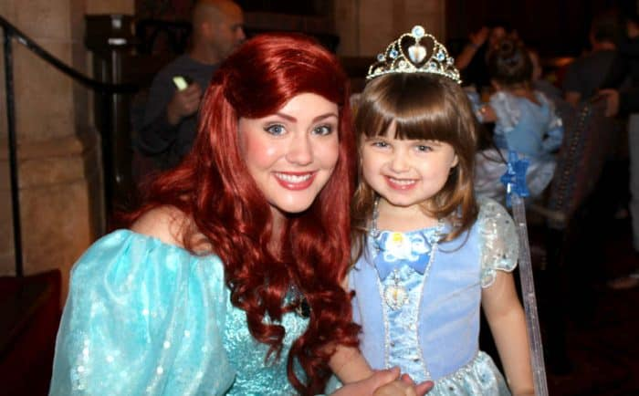 Princess Ariel and young girl with a crown and wand on the list of Disney princesses