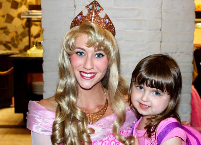 Disney Princess Aurora and young girl both in pink