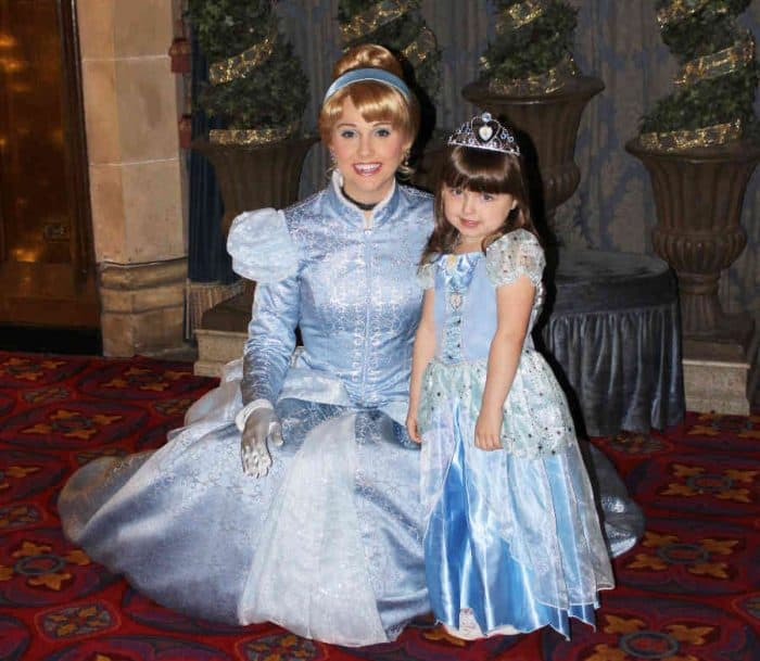 All of Disneys princesses - Princess Cinderella with young girl both in blue ball gowns