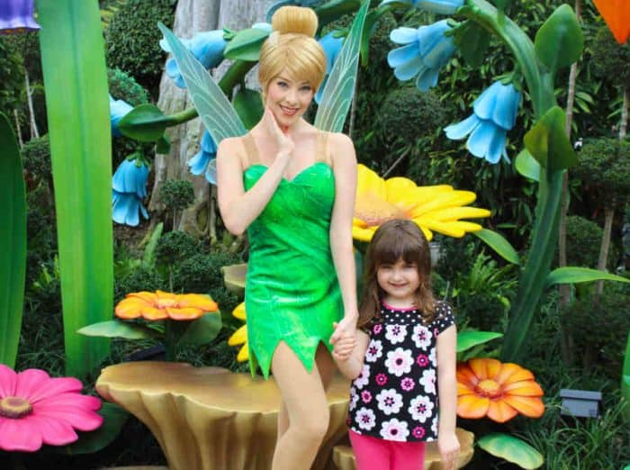 Tinker Bell posing with a young girl.