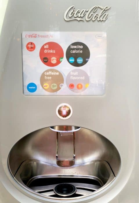 Coca Cola Freestyle refill machine; Stainless steel area to place cup holder with a computer screen where you choose which flavor you want.