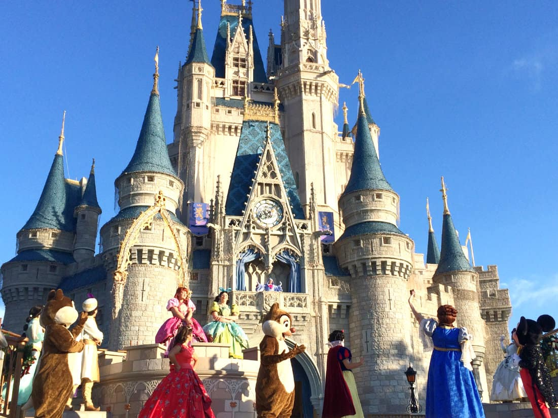 Disney characters dancing in front of Cindarella's castle at the Welcome Party
