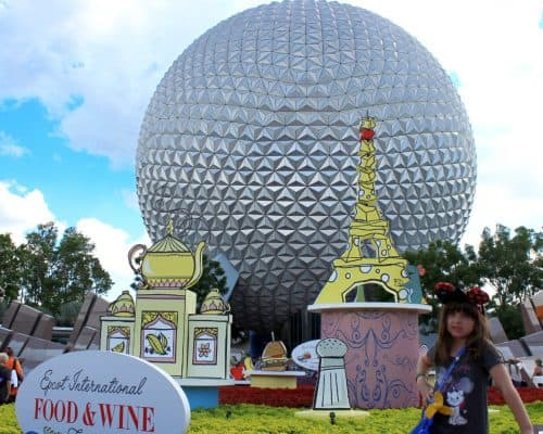Standing in front of Spaceship Earth at Epcot's main entrance during the Food and Wine Festival