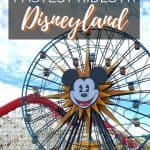 Large blue ferris wheel with a Mickey Mouse head in the center with yellow sunburst around it; in front of a white wooden roller coaster than has a red tube enclosure; text saying 8 fastest rides at Disneyland on top written in white letters.