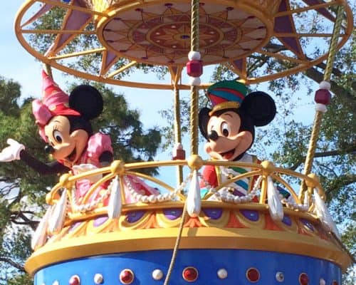 Mickey and Minnie in a hot-air balloon float wave to the crowd in the finale of Disney's Festival of Fantasy parade.