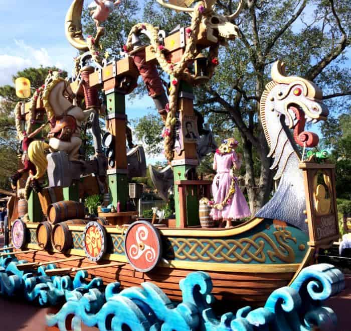 Huge wooden boat float featuring the movie Tangled with Rapunzel's long, braided blond hair weaving in and out of the top of the boat in Disney's Festival of Fantasy parade route.