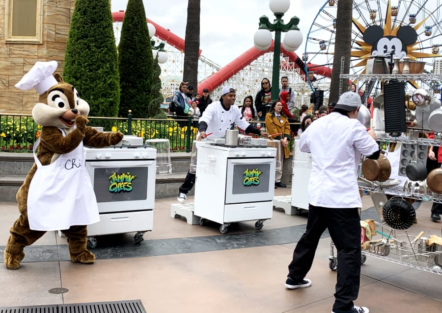 Pretend Jammin' Chefs percussion band with Disney's Chip in a white apron and chefs hat dancing to the music created by a chef banging on kitchen instruments
