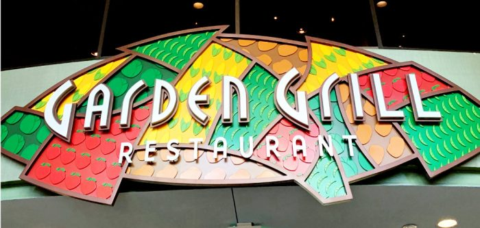 Yellow, green, red and brown background with white lettering on top that reads Garden Grill Restaurant