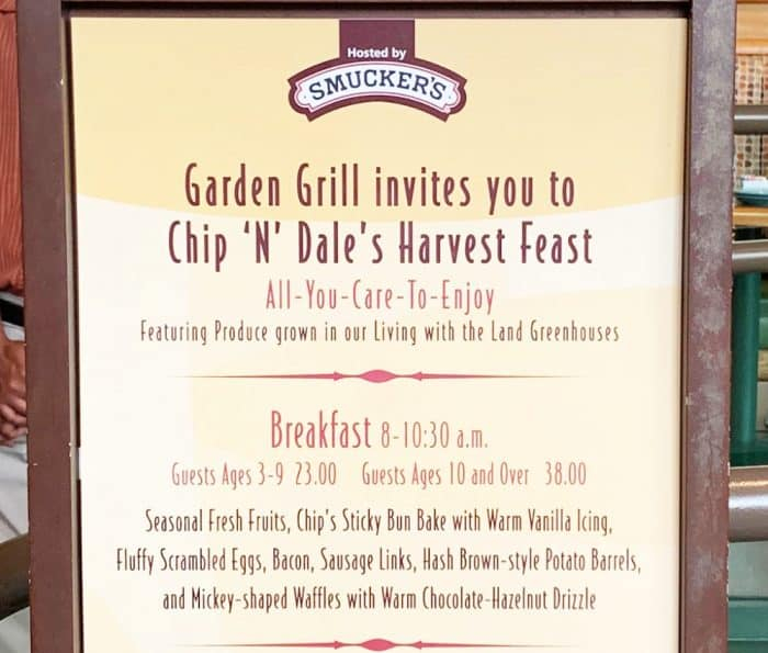 Tall sign outlined in brown with a tan background and brown writing listing the menu contents for The Garden Grill breakfast n Epcot