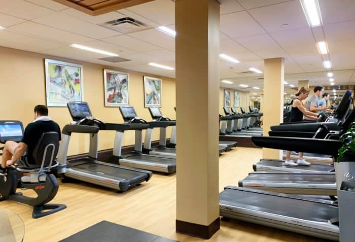 Room full of treadmills side by side