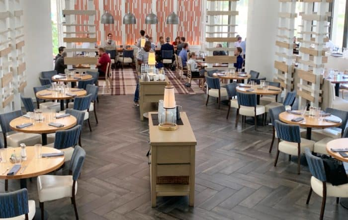 Restaurant tables and chairs with a buffet in the center
