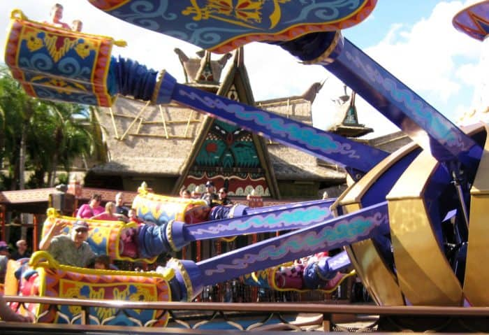 Purple and gold Aladdin ride at Magic Kingdom with magic carpets flying around a central point