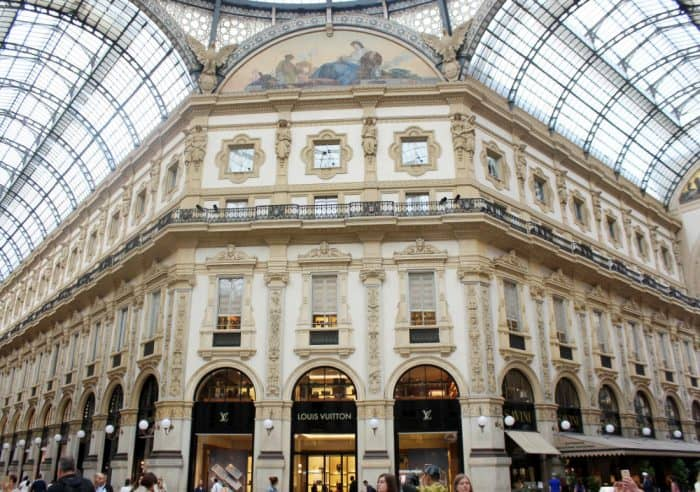 standing in the Milan Galleria center and looking up at the intricate design