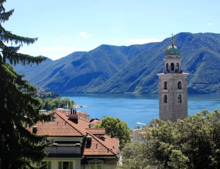 Milan with kids - the mountains and lakes of Lugano with a bell tower in the foreground