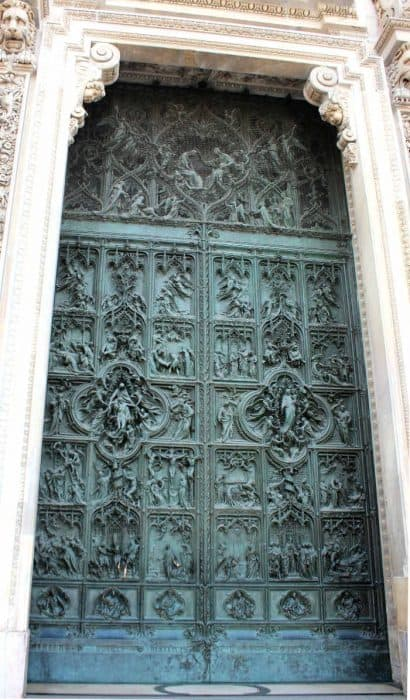 Iron doors with intricate detail of Milan Duomo