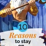 Large purple and gold statue of a man with white hair and beard holding a triton with a text overlay that reads 10 reasons to stay on Disney Property.