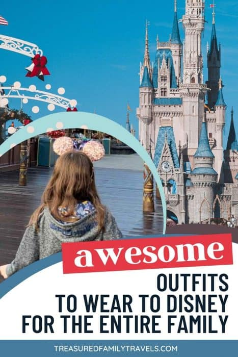 Cinderella's castle with a young girl in a Disney outfit looking out from a white rope at Disney