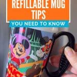 Plastic travel cup with black handle and brightly colored Disney characters