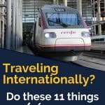 White and red train on a track with gray columns in the station behind a text overlay that says 'Traveling internationally? Do these 11 things before you leave'