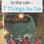 Text overlay with people standing in the rain under a sign at Frontierland in Disney World