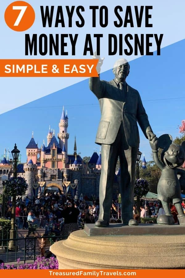 Large bronze statues of Walt disney and Mickey Mouse in front of Disneyland's castle