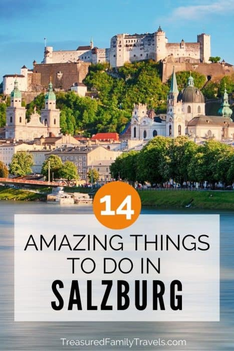 Grand fortress on top of a hill looking over the city and river with the text 14 amazing things to do in Salzburg