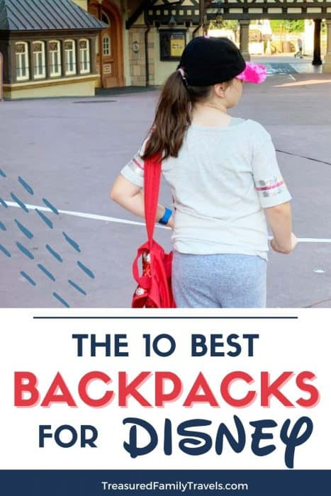 Young girl leaning on a white rope carrying a red backpack to Disney with her back to the camera