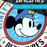Round sign with Mickey Mouse head in the center and the words Disney's Magical Express Departures written around it
