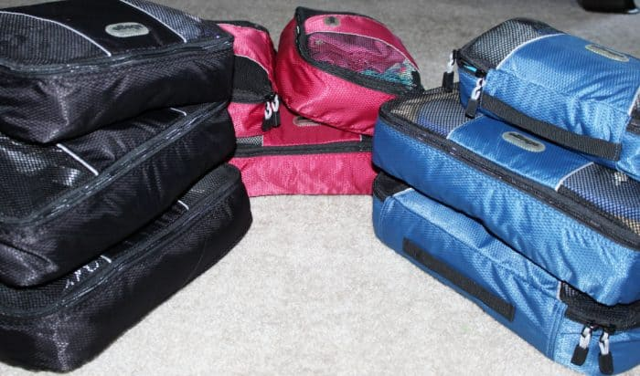Black, pink and blue sets of packing cubes