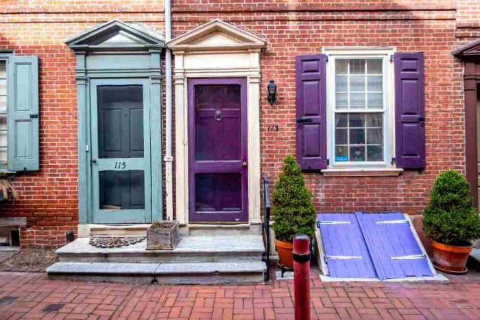Turquoise and purple doors of houses on Elfreth's Alley - the oldest street in America.