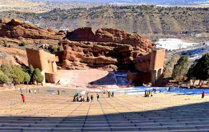 Rows of concrete steps looking down at a red rocks amphitheater.