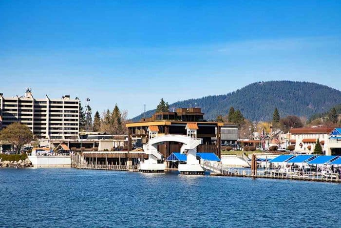 City of Coeur d'Alene situated on a lake with the mountains behind it.